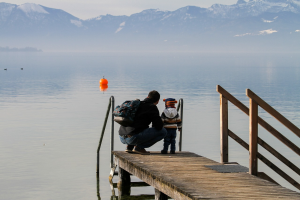father and child on dock